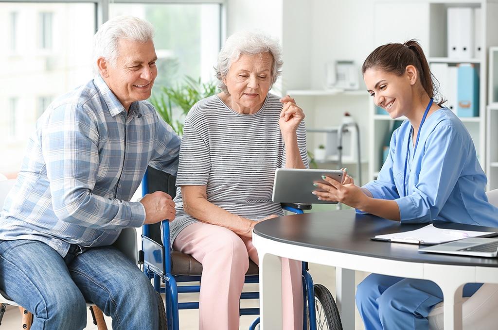 Elderly people with caregiver in nursing home
